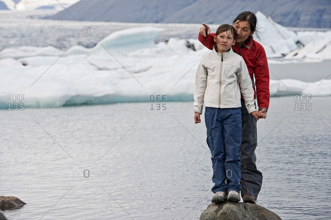Mother and daughter exploring glacier lagoon in Iceland