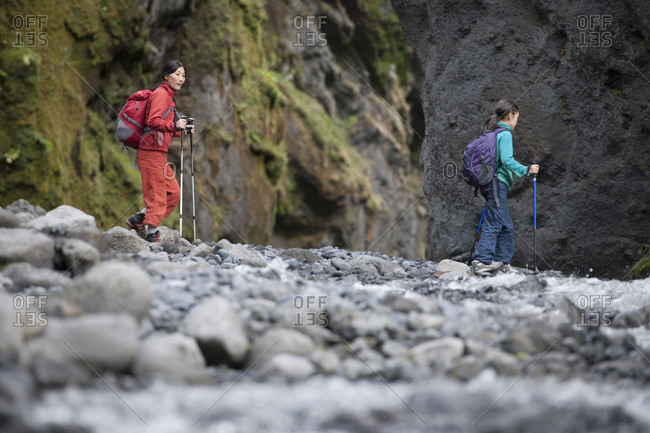 Mother and daughter hiking through canyon in Iceland