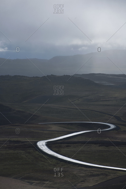 empty road meandering through dramatic landscape in north Iceland