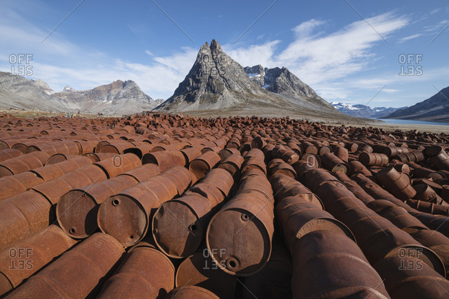 Tasiilaq, Sermersooq Municipality, Greenland - September 3, 2019: Piles of rusting fuel drums of abandoned US WW2 base Bluie East Two, Ikateq, Greenland