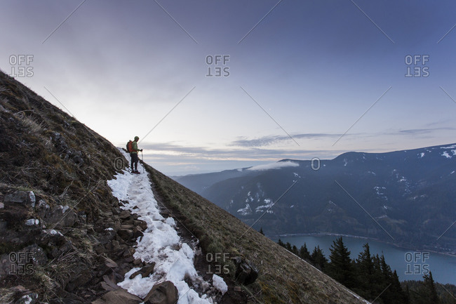 A young man climbs to the top of Dog Mountain in the Columbia Gorge.