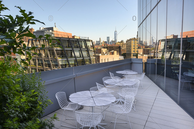 A balcony with views of New York City.