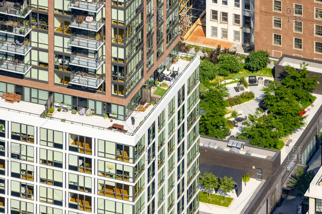 New York, New York - July 2, 2020: A Brooklyn roof deck with large glass balconies.