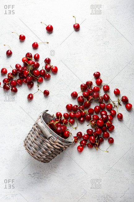 Overhead view of cherries out of bucket