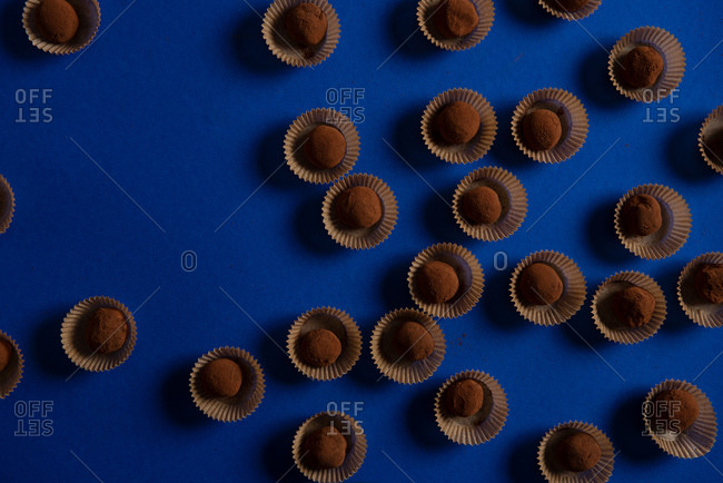 Abundance of chocolate truffles on blue background
