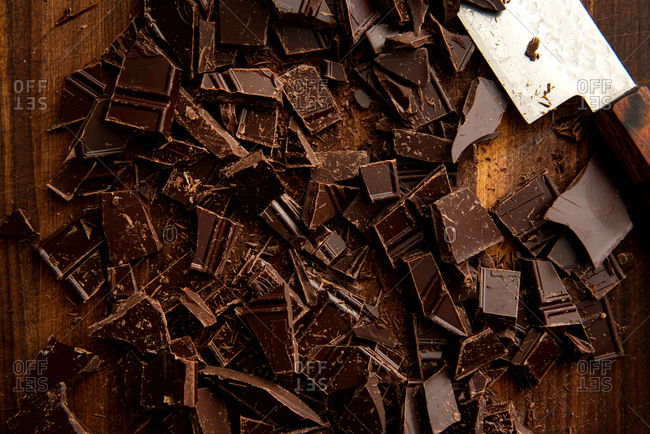 Chopped chocolate on wooden board