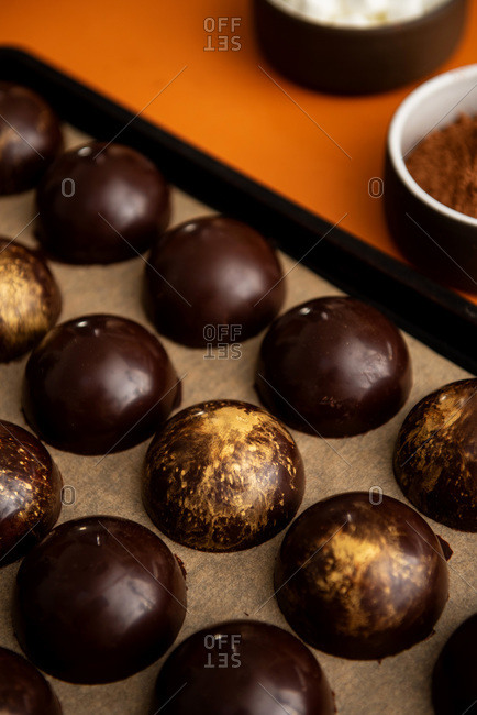 Molded chocolate shells for hot chocolate bombs