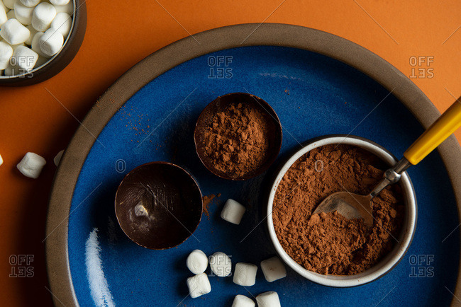 Partially filled chocolate shells for hot chocolate bombs