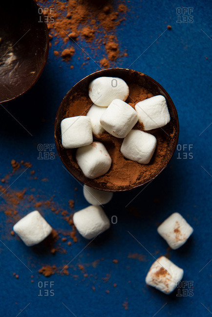 Overhead view of partially filled chocolate shells for hot chocolate bombs