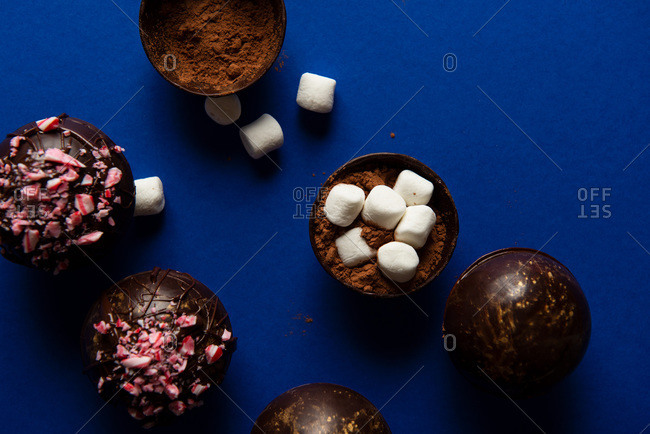 Hot chocolate bombs in various stages of completion