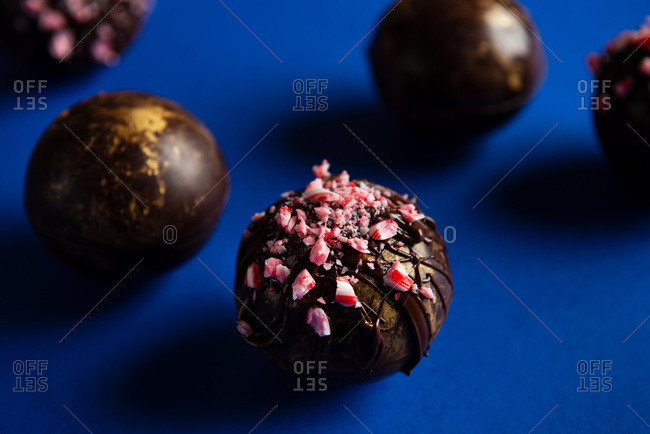 Hot chocolate bombs on blue background