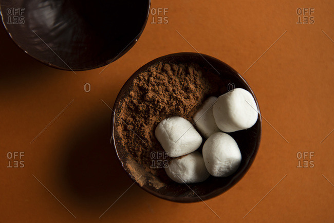 Inside a hot chocolate bomb, with hot cocoa powder and mini marshmallows