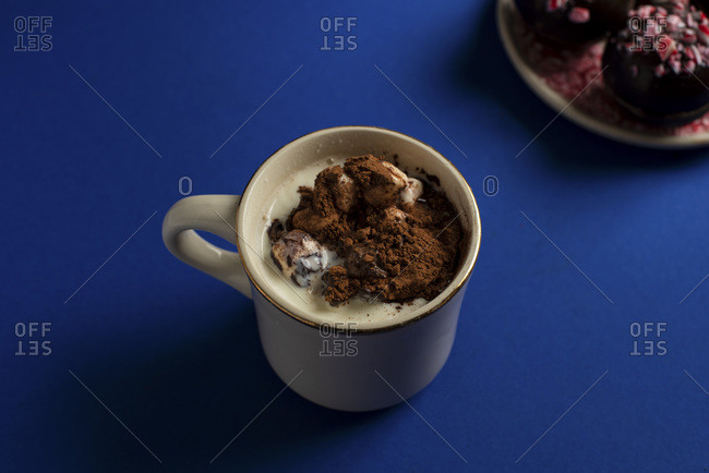 Hot chocolate bomb in mug of hot milk after exploding