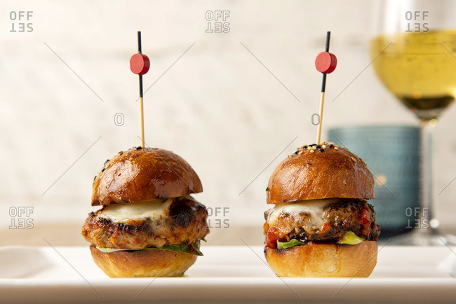 Two octopus slider burgers on white plate