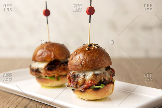 Close up of two octopus slider burgers on white plate