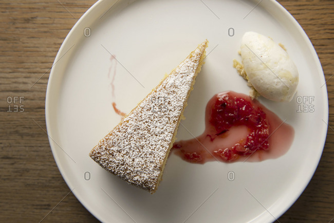Olive oil cake with whipped cream and berry jam