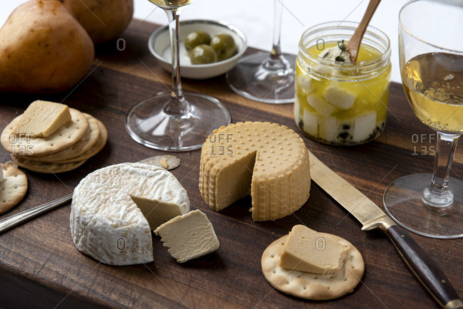 Wooden board with plant based, dairy free cheeses and crackers