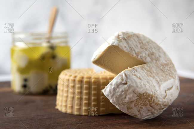 Variety of plant based, dairy free cheeses on wooden board