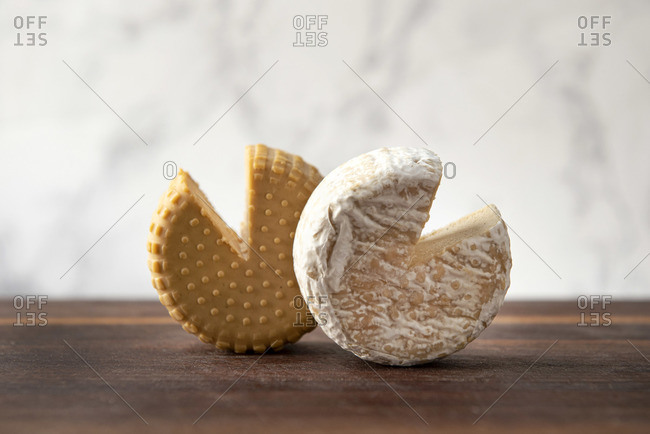 Two plant based, dairy free cheeses on wooden board