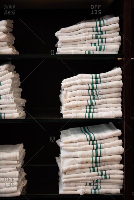 Stacks of folded linen napkins in restaurant