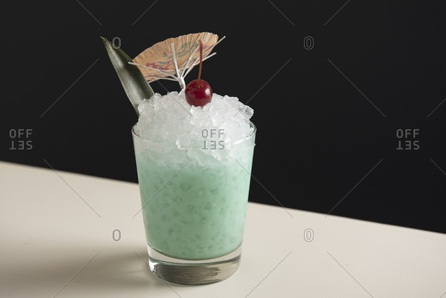 Blue tiki cocktail on pebble ice