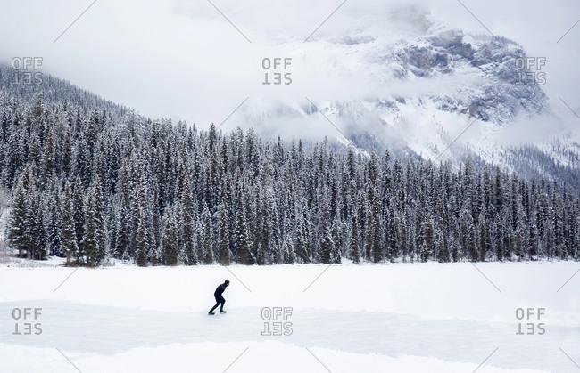 Field, British Columbia, Canada - November 23, 2018: Single male skier at Emerald Lake in winter