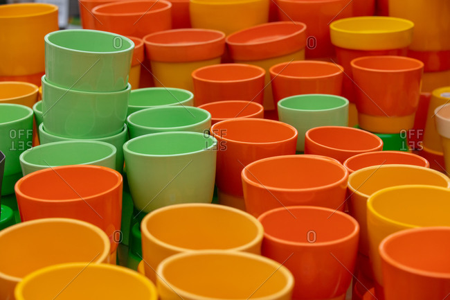 Orange and green pots for sale in a garden store
