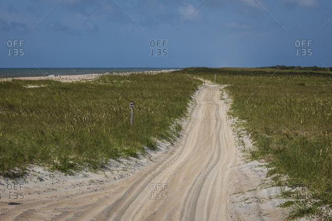 Sand path leading towards beach at Cape Lookout National Seashore, Davis, North Carolina