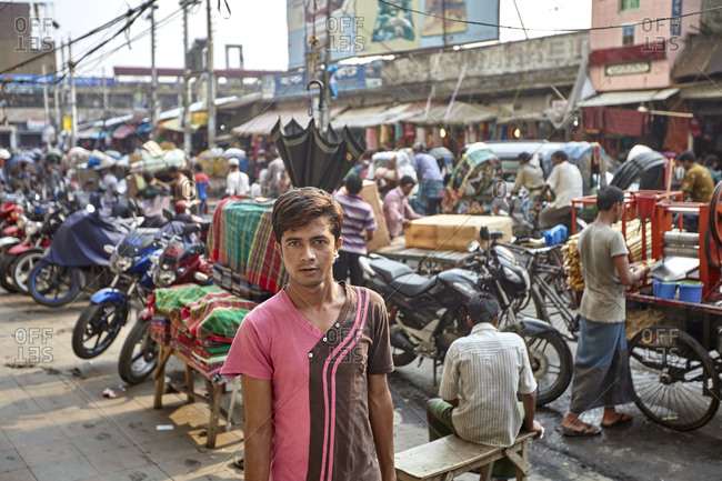 Dhaka, Bangladesh - April 27, 2013: April 27, 2013; A boy posing on a very busy market street in Dhaka