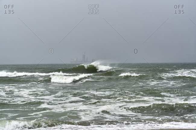 A big wave just in front of a ship in a stormy sea in Varna, Bulgaria