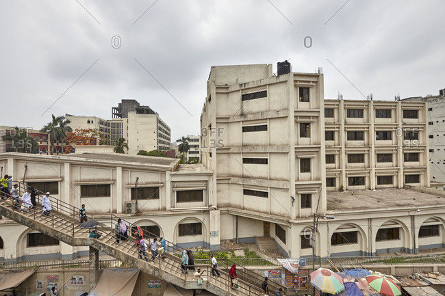 Dhaka, Bangladesh - April 26, 2013: People walking on stairs in a busy area of Dhaka