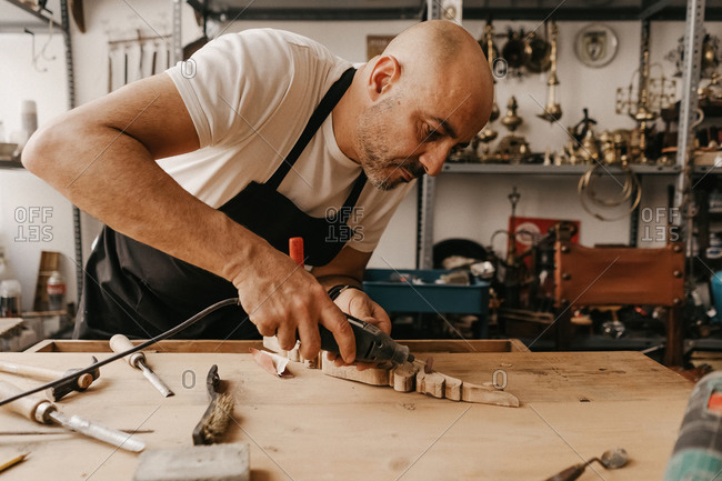 Artisan working with tools at carpentry workbench