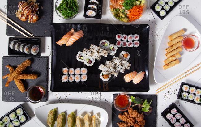 From above of various sushi and rolls placed on table in Asian restaurant