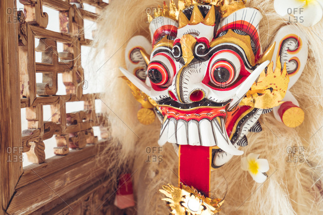 Authentic Asian lion figure with fur and colorful ornament on face used during cultural and religious celebrations and symbolizing luck and fortune placed in hotel in Taiwan