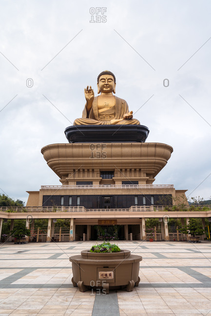 Spectacular stone building with Buddha statue