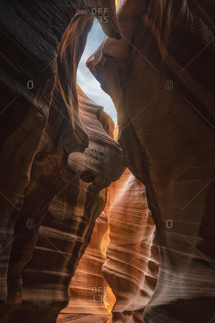 Low angle of spectacular view of Antelope Canyon with smooth brown surface located in Arizona