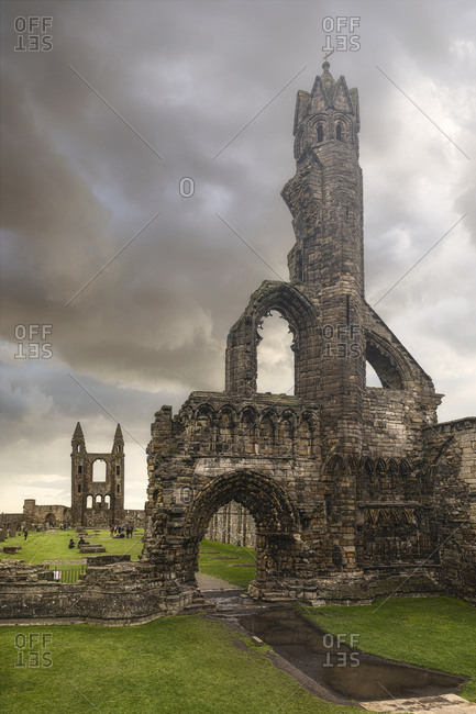 Amazing view of ruins of Saint Andrews Cathedral against gray cloudy sky in Scotland