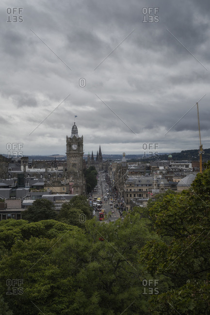 Drone view of amazing cityscape of Edinburgh under gray cloudy sky in Scotland