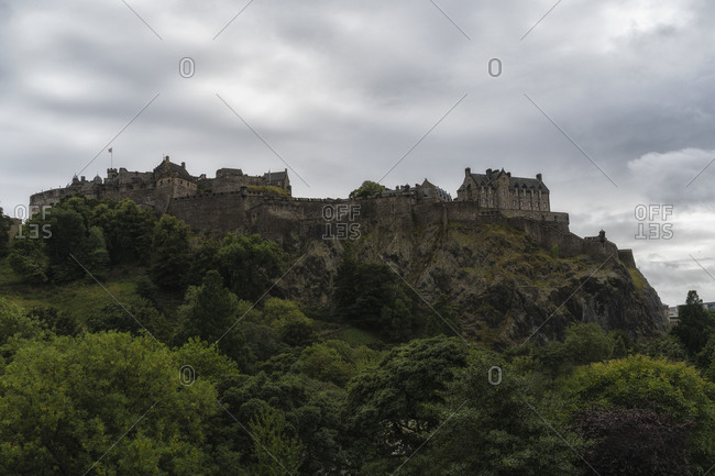 Low angle of spectacular scenery of ancient Edinburgh Castle on background of gray sky in Scotland