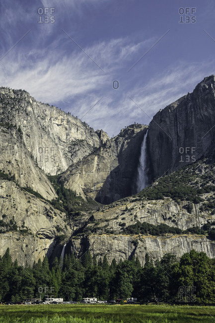Spectacular scenery of waterfall in rocky mountains in Yosemite National Park on sunny day