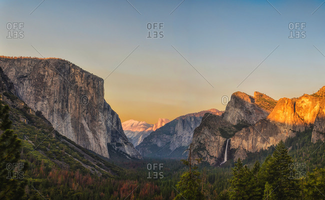 Magnificent scenery of mountain ridge lit by sunset light in evening in Yosemite National Park