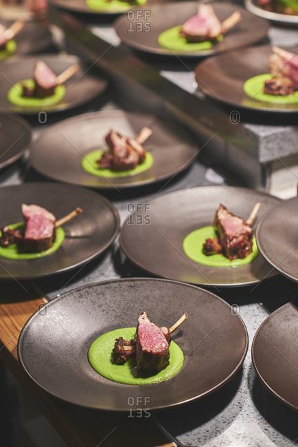Chefs preparing beautiful dishes in French restaurant's kitchen