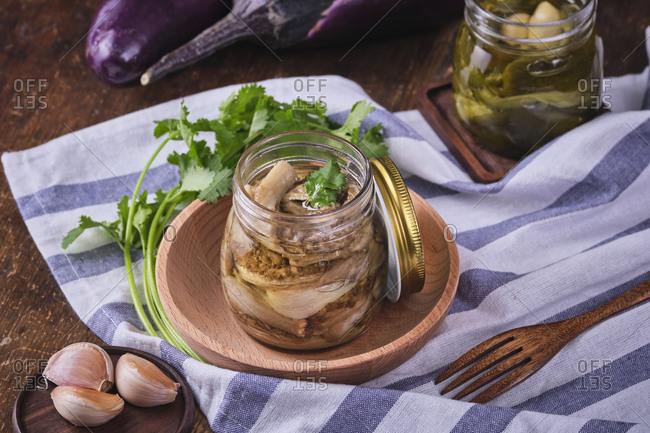 Vegan baked eggplants in crystal jar.