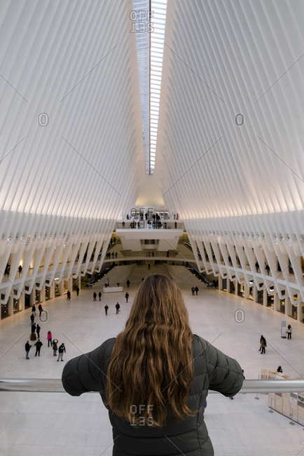 New york, ny, united states - november 14, 2017: a woman is looking the interior of the oculus