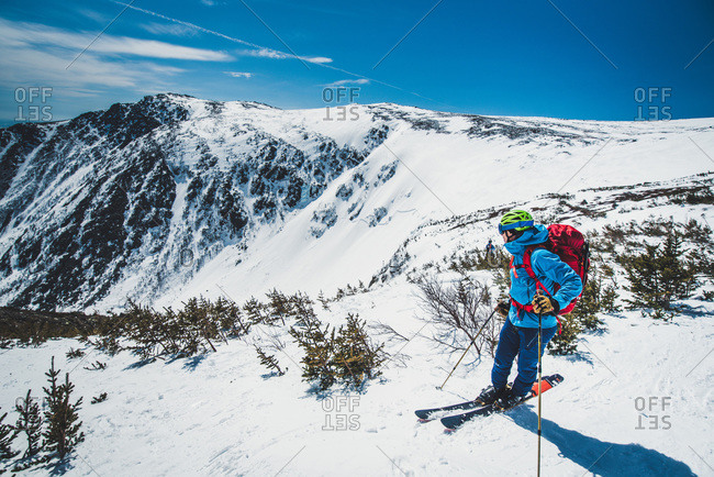 Man skier standing atop tuckerman ravine in new hampshire
