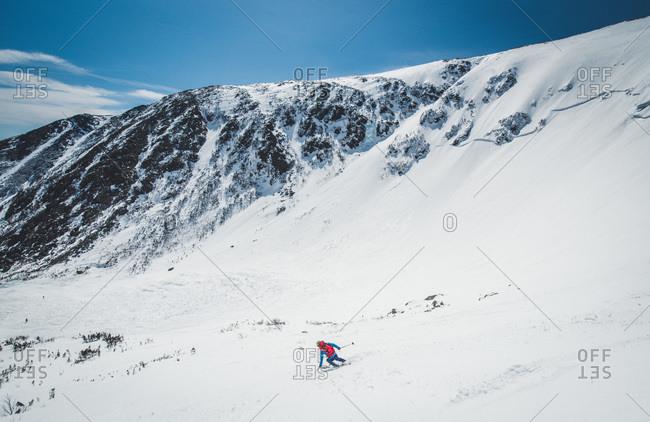 Skier descending tuckerman ravine, new hampshire