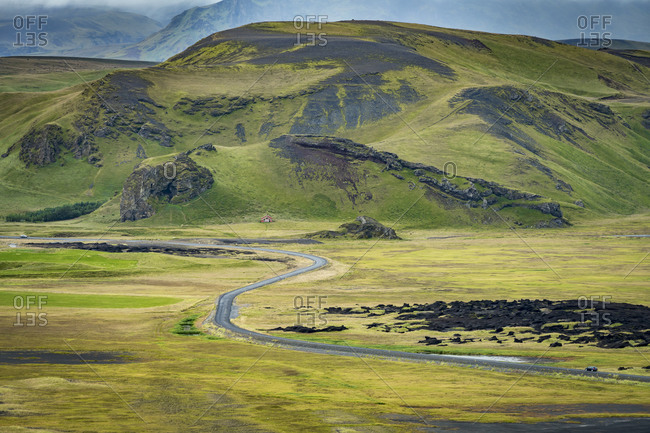 Winding road leading through mountainous landscape, south iceland, iceland