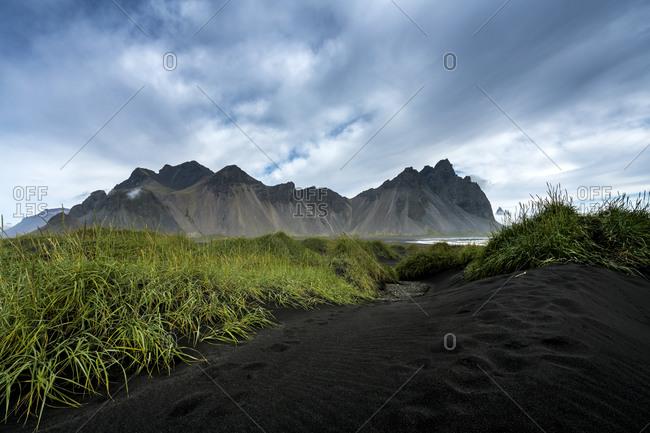 Scenic view of vestrahorn mountain range against sky at stokksnes, iceland
