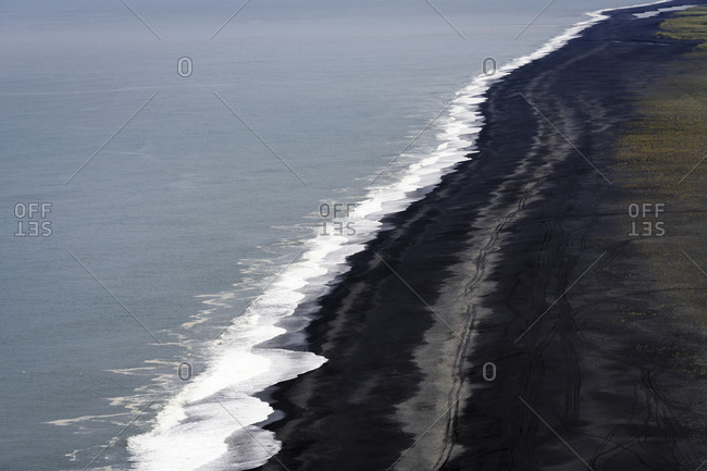 Aerial view of endless black sand beach at dyrholaey peninsula, south iceland