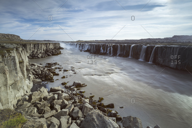 Scenic view of selfoss waterfall on jokulsa a fjollum river against sky, northern iceland